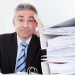 man going through a stack of taxes